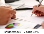 Small photo of Arm fill and sign important form clipped to pad with silver pen closeup. Make note gesture read pact sale agent bank job loan credit mortgage investment finance chief legal law take part in campaign