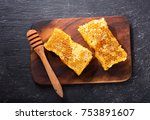 honeycombs on wooden board  top ... | Shutterstock . vector #753891607