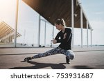Young athelete woman stratching before intensive morning workout, sporty girl training outdoor wearing stylish sportswear, healthy lifestyle