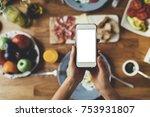 closeup of female hands holding ... | Shutterstock . vector #753931807
