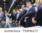 a group of businessmen near a... | Shutterstock . vector #753946177