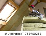 man installing thermal roof... | Shutterstock . vector #753960253