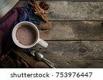 winter hot chocolate on rustic...   Shutterstock . vector #753976447