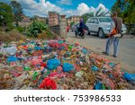 Small photo of KATHMANDU, NEPAL - DEC 22, 2013: Food and pile of domestic garbage in landfill. Only 35 of population have access to adequate sanitation.