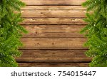 wood background with fir branch ... | Shutterstock . vector #754015447