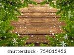 wood background with fir branch ... | Shutterstock . vector #754015453
