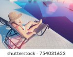 young woman in hat lying on a... | Shutterstock . vector #754031623