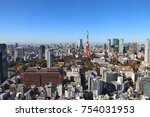 Small photo of Tokyo city skyline - aerial view with Roppongi and Minato wards. Mount Fuji visible in far left background.