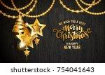 merry christmas golden text.... | Shutterstock .eps vector #754041643