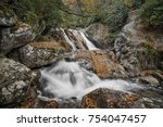 Small photo of Sunburst Falls North Carolina. Beautiful cascading waterfall right along NC 215 just a few miles north of the Blue Ridge Parkway. Seen here with autumn colors on a misty day in October.
