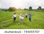 group of children running on... | Shutterstock . vector #754055707