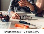 fixing robotic arm | Shutterstock . vector #754063297