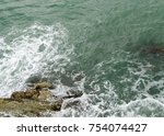 waves crushes at the cliffs.... | Shutterstock . vector #754074427