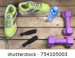 sports sneakers  dumbbells ... | Shutterstock . vector #754105003