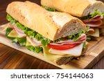 baguette sandwich cut in half... | Shutterstock . vector #754144063