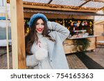 adorable girl with long brown... | Shutterstock . vector #754165363