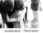 a mommy hugging her little boy | Shutterstock . vector #754176967