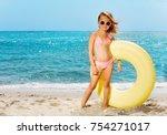 little girl with big rubber... | Shutterstock . vector #754271017