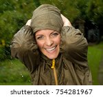 a woman in the rain smiling | Shutterstock . vector #754281967