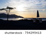 sunset with deckchair on the... | Shutterstock . vector #754295413