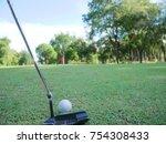 putter golf ball on the green | Shutterstock . vector #754308433