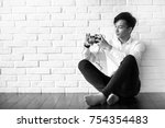 asian young man uses a camera... | Shutterstock . vector #754354483