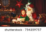 santa claus reads letter to... | Shutterstock . vector #754359757