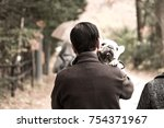 owners and dogs.   Shutterstock . vector #754371967