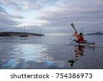 woman kayaking in the ocean... | Shutterstock . vector #754386973