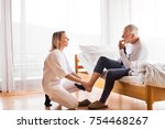 health visitor and a senior man ... | Shutterstock . vector #754468267