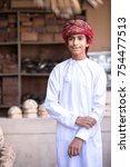 Small photo of Nizwa, Oman - Nov 10, 2017: Portrait of a young Omani boy in a traditional outfit.