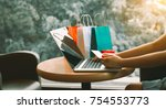 woman using credit card with... | Shutterstock . vector #754553773