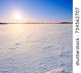 winter field covered with snow... | Shutterstock . vector #754562707