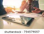 business team meeting working... | Shutterstock . vector #754579057
