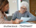 home assistant helping elderly... | Shutterstock . vector #754596607