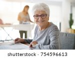 portrait of old woman reading... | Shutterstock . vector #754596613