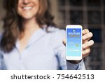 happy woman showing a mobile... | Shutterstock . vector #754642513