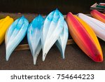 colorful kayaks in row | Shutterstock . vector #754644223