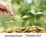hand giving a coin to trees... | Shutterstock . vector #754681507