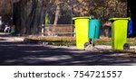 plastic trash can in the park | Shutterstock . vector #754721557