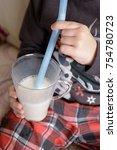 boy in pajamas drinking milk... | Shutterstock . vector #754780723