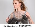 young woman cooling face under... | Shutterstock . vector #754782703