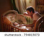 dad puts his son to bed. before ... | Shutterstock . vector #754815073