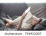 beautiful girl reading a book...   Shutterstock . vector #754912207