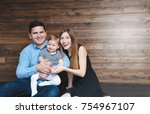 happy family sitting on floor... | Shutterstock . vector #754967107