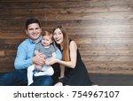 happy family sitting on floor... | Shutterstock . vector #754967107