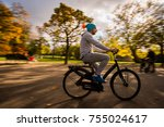 young attractive man riding... | Shutterstock . vector #755024617