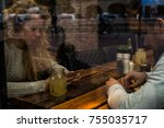 young couple using mobile phone ... | Shutterstock . vector #755035717
