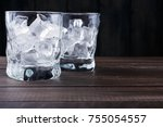 glasses with ice cubes on dark... | Shutterstock . vector #755054557