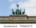 Small photo of The quadriga (chariot drawn by four horses abreast) of the Brandenburg gate in Berlin, Germany.